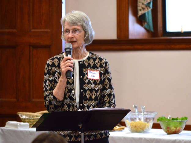 """Sister Marcia Allen welcomes participants to the 30th in a series of """"working lunches"""" at the Nazareth Motherhouse today (Oct. 14)."""