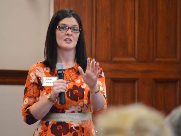 CloudCorp executive director Ashley Hutchinson answers questions during Tuesday's Community Needs Forum working lunch at the Nazareth Motherhouse.