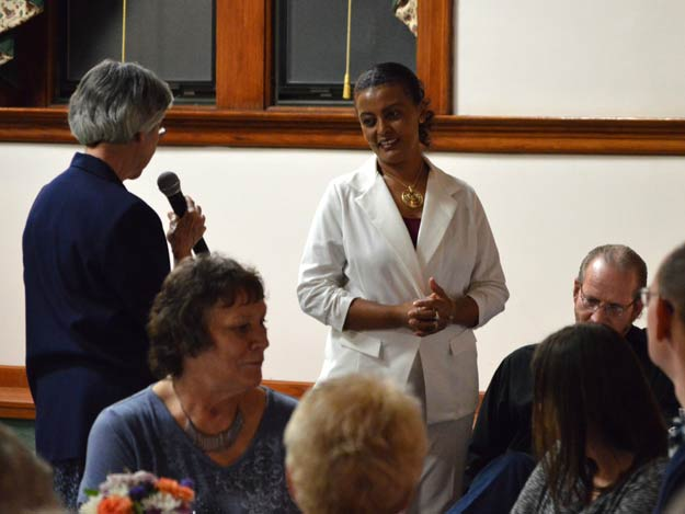Sister Judy Stephens, left, recognizes Hadas Harrington for her five years of service as a nurse aide at the Nazareth Motherhouse.