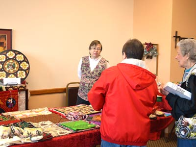 Sister Christine Carbotte volunteered to help with sales during the annual Holiday Boutique at Neighbor to Neighbor in November 2015.