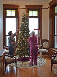 In late November 2015, Sister Patricia Urbinelli, left, and Sister Beth Stover decorate a Christmas tree in a fourth floor alcove at the Concordia Motherhouse.