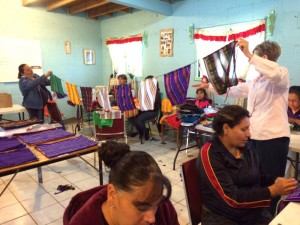 """The """"assembly line"""" for prayer flags at the sewing co-op in Juarez, Mexico."""