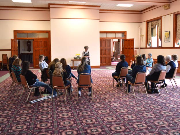 Sister Janet Lander leads a discussion with the 15 Sacred Heart High School seniors taking part in a daylong retreat at the Nazareth Motherhouse today.