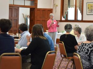 Lunch participants listen as Sister Marcia Allen welcomes them to today's 32nd gathering of the Community Needs Forum.