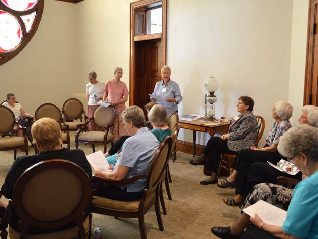 """Inquirers"" and Sisters of St. Joseph gather Saturday afternoon for an educational session in the fourth-floor ""Rose Room"" at the Nazareth Motherhouse. Standing, from left, are Sisters Lorren Harbin, Marcia Allen and Dian Hall."