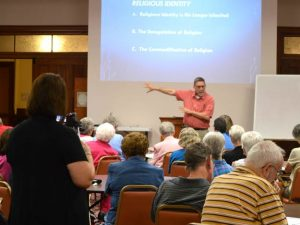 Susan LeDuc of Manna House of Prayer videotapes all four days of the annual Theological Institute held at the Nazareth Motherhouse.