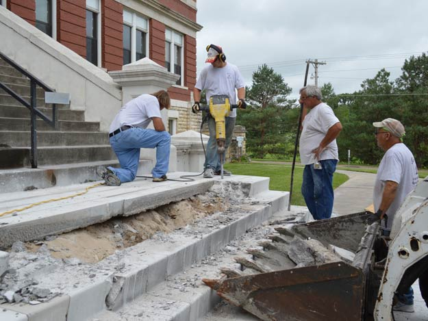 Terry Budreau, left, checks on the progress to remove the old concrete steps this morning at the Nazareth Motherhouse.
